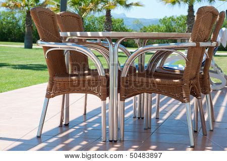 Chairs and table near apartments