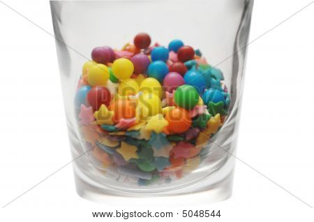 Sprinkles And Candy In Glass