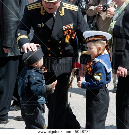 Veteran And His Grandson.