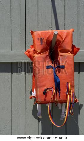 Life Vest On Wooden Pole