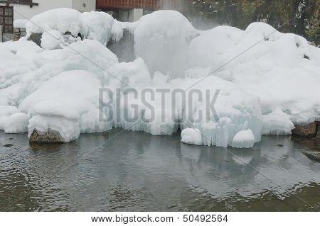 Frozen fountain in mountain in winter