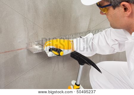 Worker Fixing A Lath