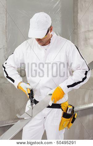 Worker Cutting Lath By Stencil