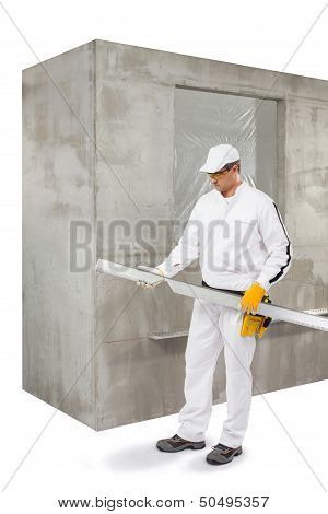 Worker With A Lath