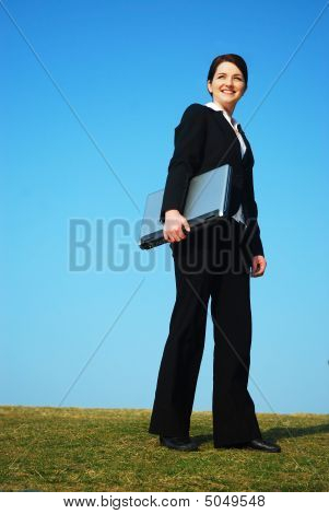 Businesswoman Outdoors Holding Laptop
