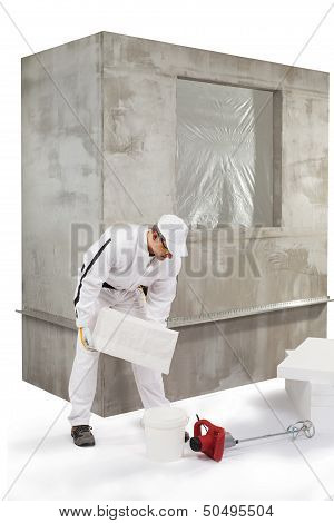 Worker Pouring Out An Insulation Adhesive