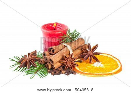 Christmas decoration with fir branch candle cinnamon
