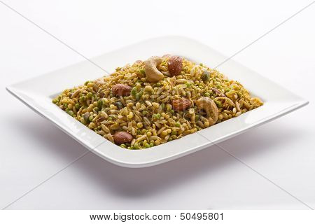 Indian snack in white plate isolated.