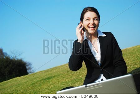 Happy Businesswoman At Work Outdoors