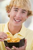 Teenage Boy Eating French Fries