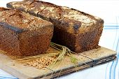 pic of home-made bread  - fresh home made sourdough bread loafs on chopping board - JPG