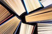 stock photo of homework  - Old and used hardback books or text books seen from above - JPG