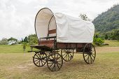 stock photo of covered wagon  - Covered wagon with white top in park - JPG