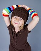 image of leg warmer  - Little girl in rainbow leg warmers on her arms - JPG