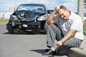 stock photo of accident emergency  - Adult upset driver man in front of automobile crash car collision accident in city road - JPG