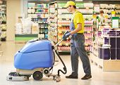 stock photo of supermarket  - Floor care and cleaning services with washing machine in supermarket shop store - JPG