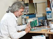 picture of microchips  - male technicial engineer with microchip plate at test laboratory factory - JPG