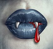 picture of bloody  - Horror Vampire bloody teeth and fangs with a gothic style female with black lips and human liquid blood dripping from the mouth against ghost like white skin as a demon concept and Halloween symbol of mystery and spooky fantasy - JPG