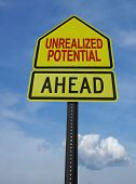 unrealized potential motivational ahead  post sign over blue sky