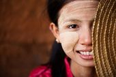 picture of shy girl  - Portrait of beautiful shy young traditional Myanmar girl with straw hat smiling - JPG