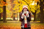 beautiful woman freezing in autumn park, cold autumn