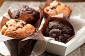 image of chocolate muffin  - blueberry and chocolate muffins in paper cupcake holder - JPG