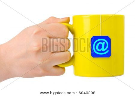 Hand And Cup Of Tea With At Symbol