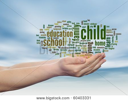 Concept or conceptual child education abstract word cloud, human man hand, blue sky background