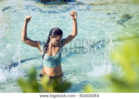Woman smiling while swimming in cristal clear watter