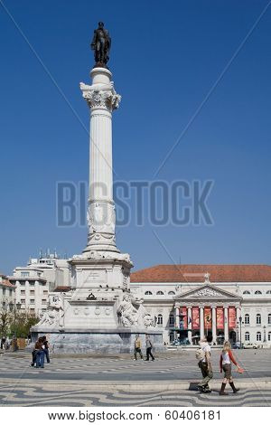 Lisbon, Portugal - April 14, 2013: Rossio (Dom Pedro IV) Square with Dom Pedro IV monument and Dona Maria II National Theatre in background