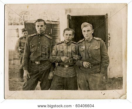MOSCOW, USSR - CIRCA 1960s : An antique photo shows Three soldiers of the Red Army in the winter uniform.