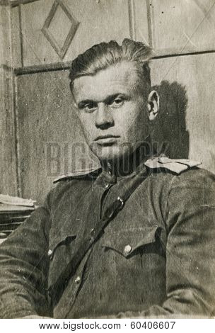 MOSCOW, USSR - CIRCA 1940s: An antique photo shows studio portrait of a Red Army officer in uniform.