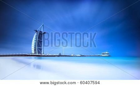 Burj Al Arab hotel on Jumeirah beach in Dubai, modern architecture, luxury beach resort, summer vacation and tourism concept