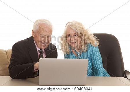 Elderly Couple Laptop Both Smile
