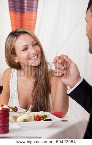 Man Holding A Womans Hand At A Romantic Dinner