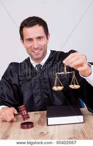 Male Judge Holding Scale