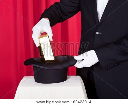 Magician Removing Bullion From Hat