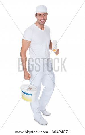 Painter Holding A Paint Roller And Bucket