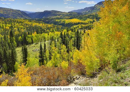 Yellow, Red And Green Aspens And Colourful Mountains Of Colorado
