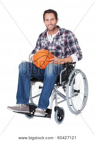 Man In Wheelchair With Basketball