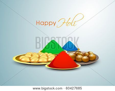 Indian festival Happy Holi background with preparation for festival colours, and sweets on blue background.