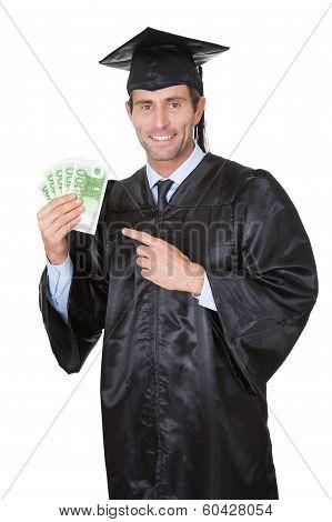 Portrait Of Happy Graduate Student With Cash