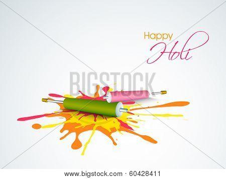 Indian festival Happy Holi celebrations concept with pichkari (colour gun) on colours splash background.