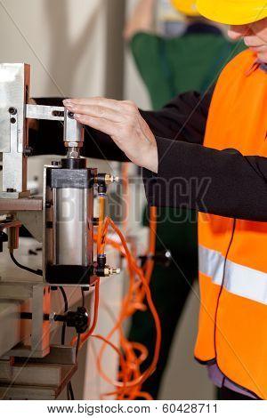 Woman Operating Lathe