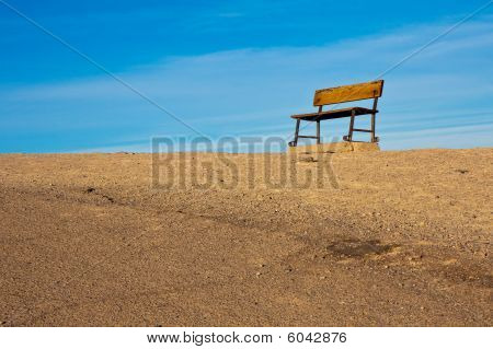 Empty Bench On A Hill