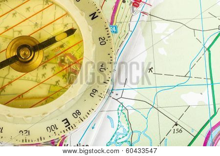 Old Touristic Compass On Map