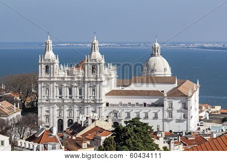 Sao Vicente de Fora Monastery, and the dome of the National Panteon (Santa Engracia church aka Panteao Nacional). Lisbon, Portugal