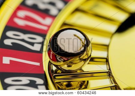 the cylinder of a roulette gambling in a casino. winning or losing is decided by chance.