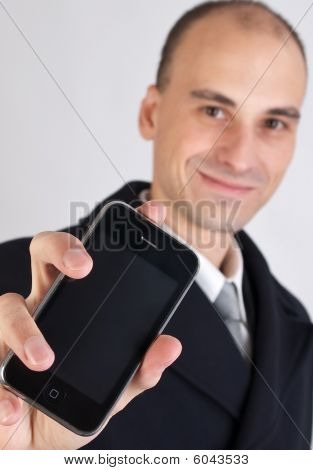Businessman Holding A Mobile Phone