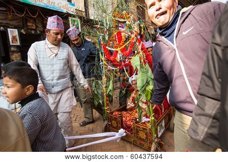 BHAKTAPUR, NEPAL - DEC 20: During Birthday celebration head of family - 77 years 7 months 7 days 7 hours old, like rebirth according to Newar, Dec 20, 2013 in Bhaktapur, Nepal.